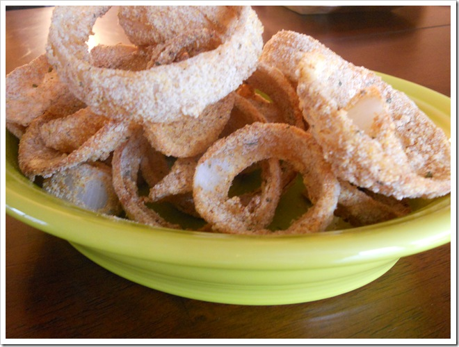 healthy baked onion rings in lemongrass fiestaware serving dish