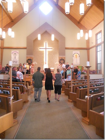mom jamie and i entering at wedding rehearsal