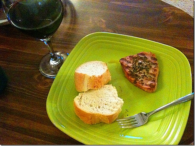 tuna steak with bread and wine